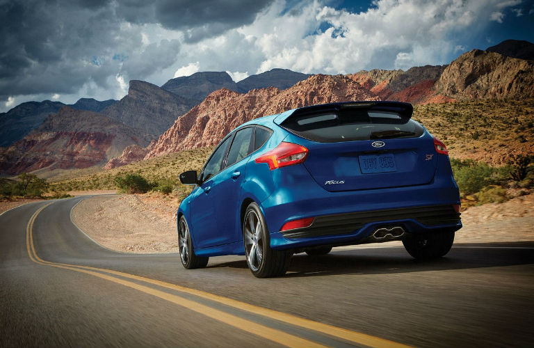 The rear side of a blue 2016 Ford Focus Hatchback.