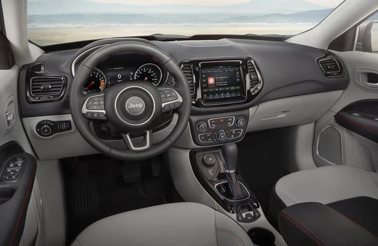 The front interior inside a 2018 Jeep Compass.
