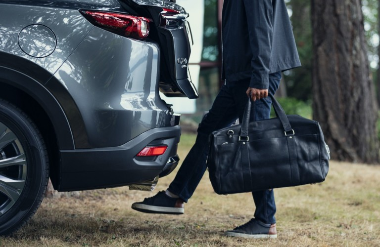 A person using the hands-free rear power liftgate in a 2020 Mazda CX-9.