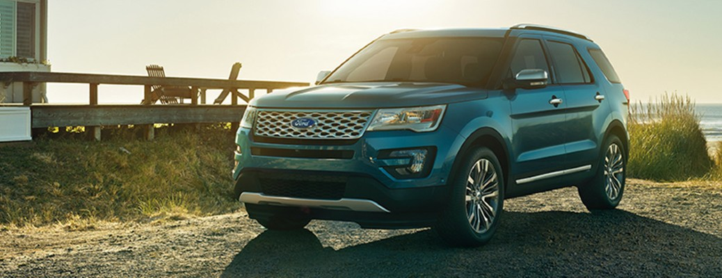 The frotn and side view of a blue 2017 Ford Explorer Platinum.