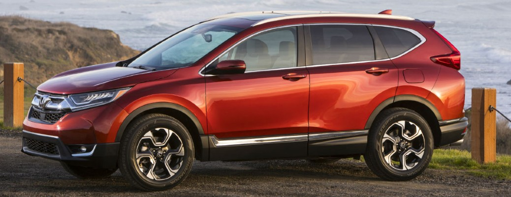 The side view of a red 2018 Honda CR-V.