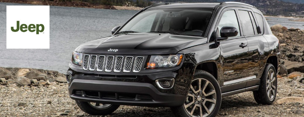 The front side of a black 2015 Jeep Compass with the 2015 Jeep Logo on the left side.