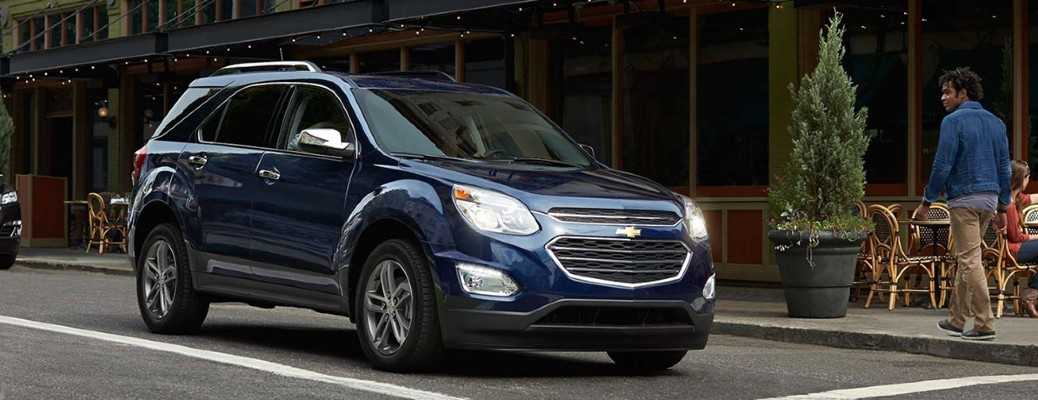 The front and side view of a dark blue 2017 Chevrolet Equinox.