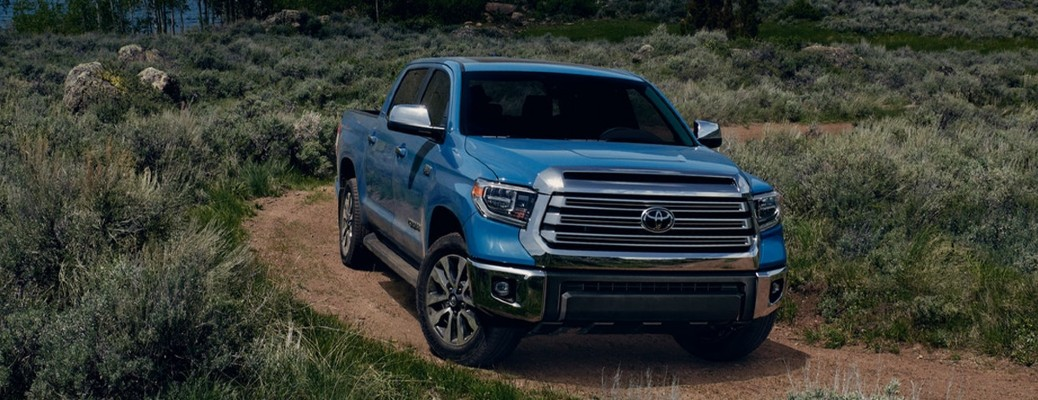 The front side of a blue 2021 Toyota Tundra.