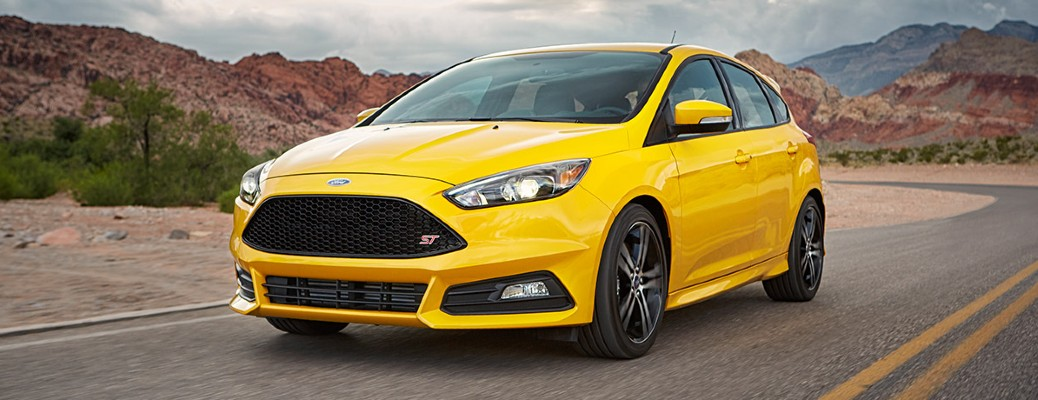 The front side of a yellow 2017 Ford Focus.