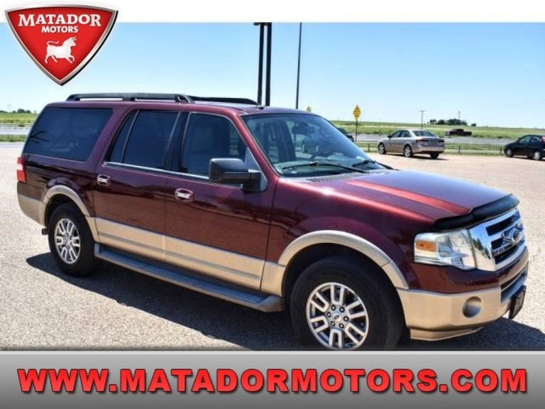 The side and front view of a burgundy 2012 Ford Expedition.