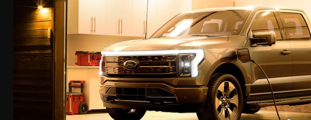 The All New 2022 Ford F-15- Lightning parked inside a garage.