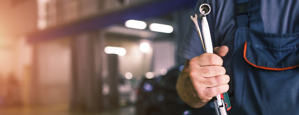 Closeup of person holding tools