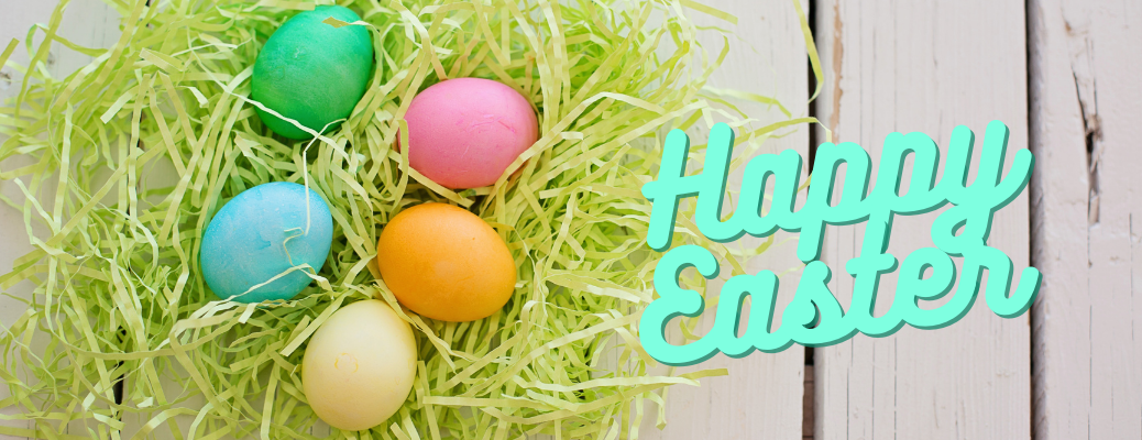 """Colorful Easter eggs in green nest with blue """"Happy Easter"""" text"""