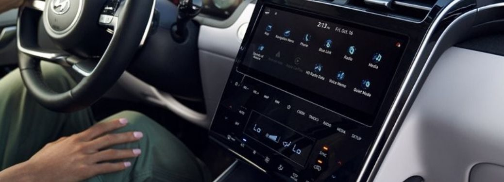 Woman Connecting to Bluetooth on Touchscreen Display in 2022 Hyundai Tucson