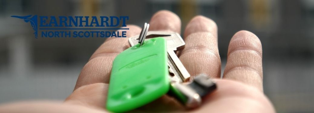 Close Up of Hand with Car Keys and Earnhardt Hyundai of North Scottsdale Logo