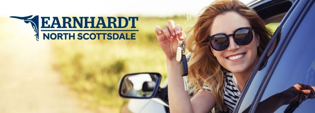 Happy Woman in a Car with Keys with Earnhardt Hyundai of North Scottsdale Logo