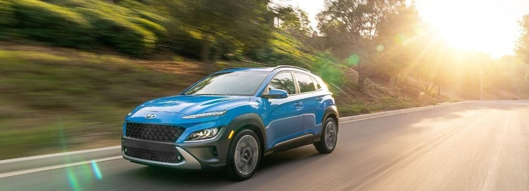 Blue 2022 Hyundai Kona on a Country Highway at Sunset