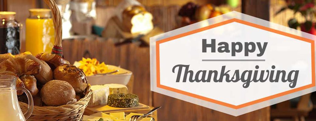 """Food and juices on table with """"Happy Thanksgiving"""" written on right side of image"""