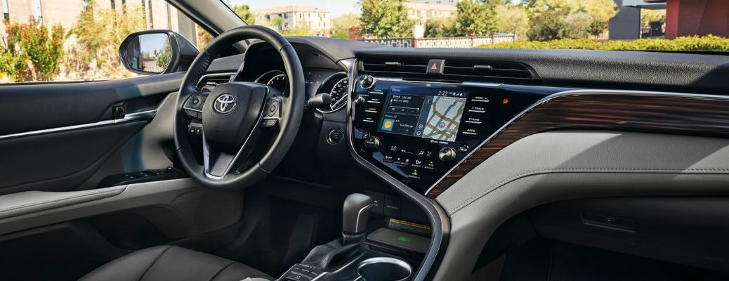 Dashboard of 2018 Toyota Camry with steering wheel and center touchscreen both visible