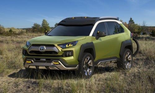 Green FT-AC Concept vehicle parked in field