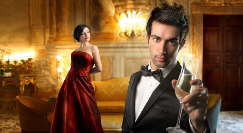 Formally dressed man and woman drinking wine inside mansion