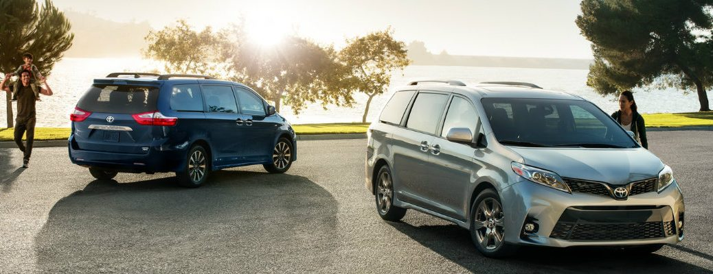 Blue and silver 2018 Toyota Sienna models parked in front of lake