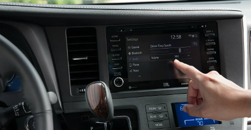 Individual operating Driver Easy Speak feature inside 2018 Toyota Sienna