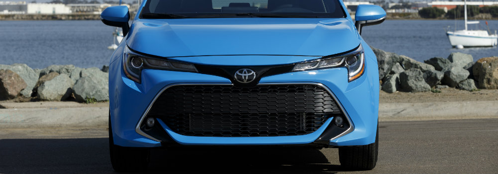 Front view of grille and headlights of blue 2019 Toyota Corolla Hatchback