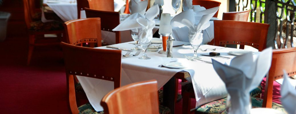 Chairs circling a table prepared for fine dining