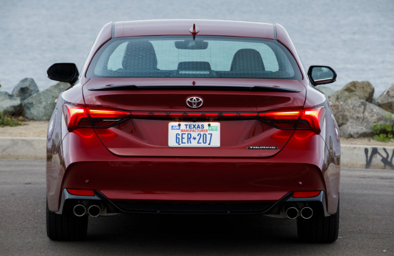 rear of red toyota avalon with texas plate