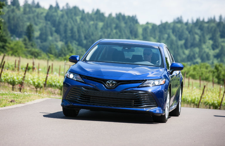 front view of blue toyota camry