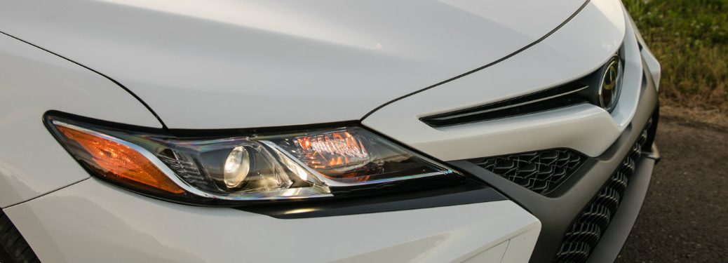 right headlight and grille of white toyota camry