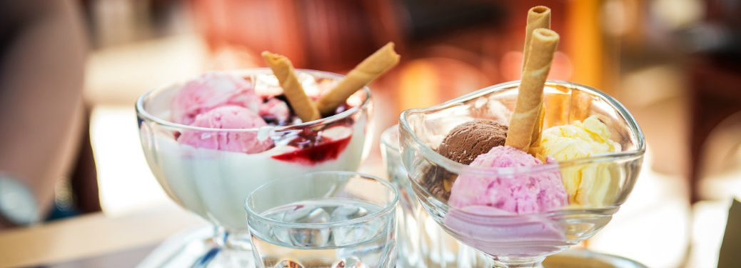 glass dishes of colorful ice cream scoops