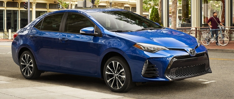 2019 Toyota Corolla blue side view on the road
