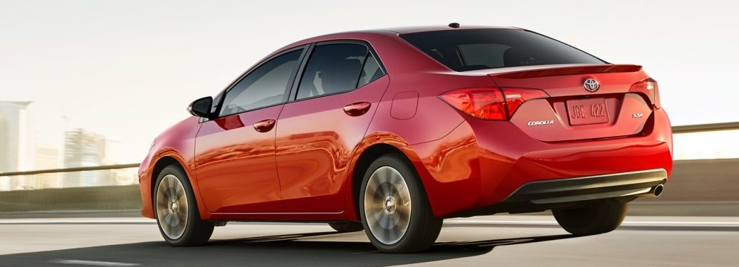 2019 Toyota Corolla red side back view on the road