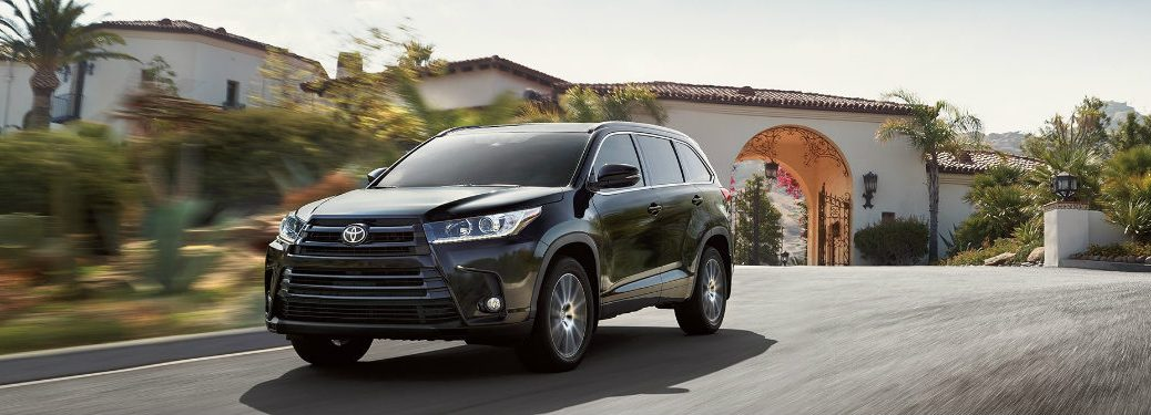 2018 Toyota Highlander driving down a road