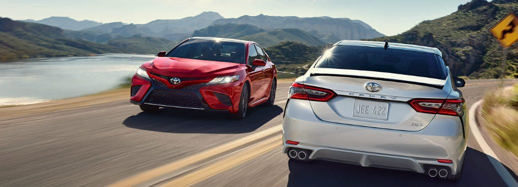 TWo 2018 Toyota Camrys passing each other on a road