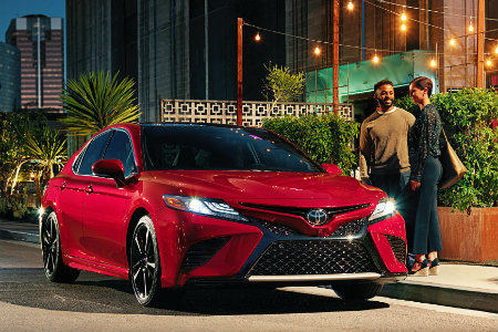 A couple getting into a 2018 Toyota Camry