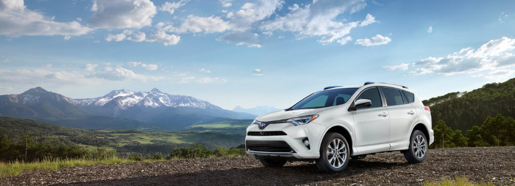 2018 Toyota RAV4 parked in front of a mountain range