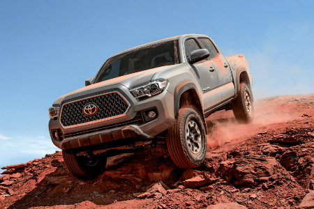 2018 Toyota Tacoma driving over a dirt hill