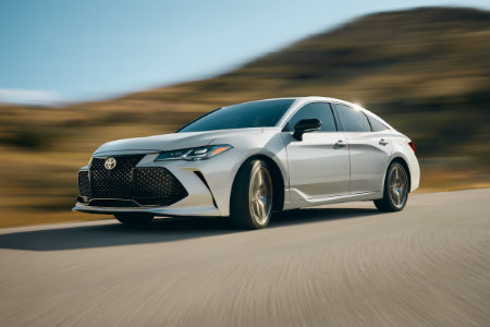 2019 Toyota Avalon driving fast down a road
