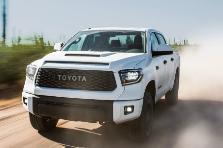 2018 Toyota Tundra driving down a rural road