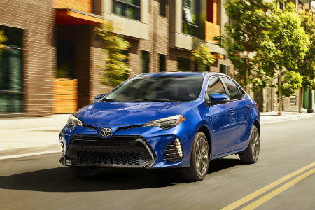 2019 Toyota Corolla driving down a city road