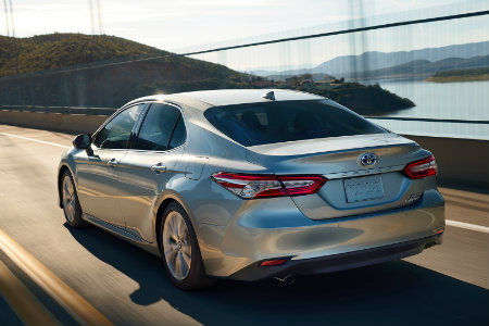 2018 Toyota Camry driving over a bridge