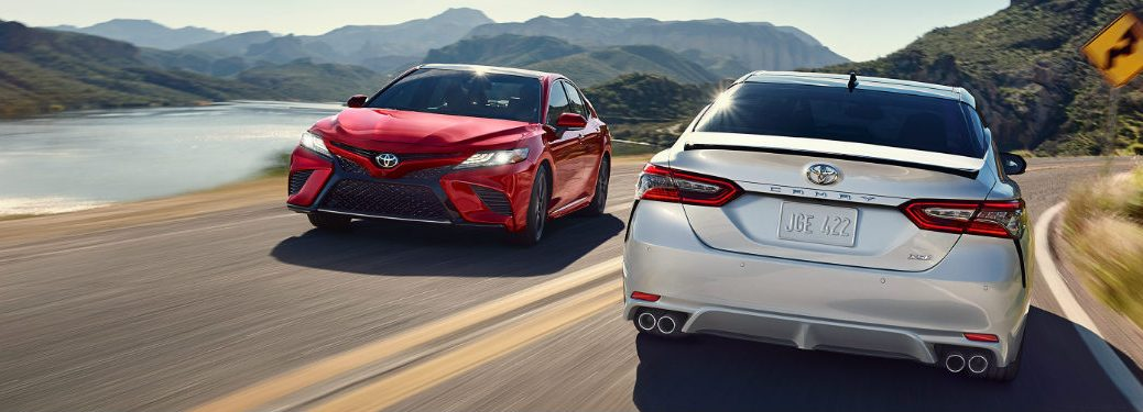 Two 2018 Toyota Camrys passing one another on a road