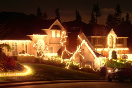 A house covered in Christmas lights and decorations