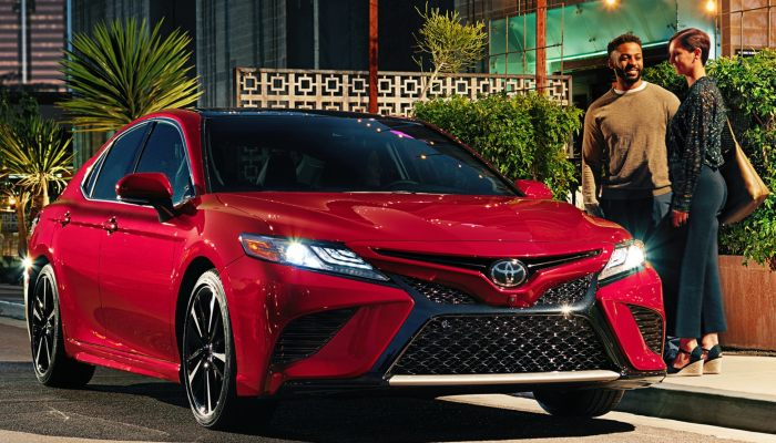 A couple gets into a 2019 Toyota Camry