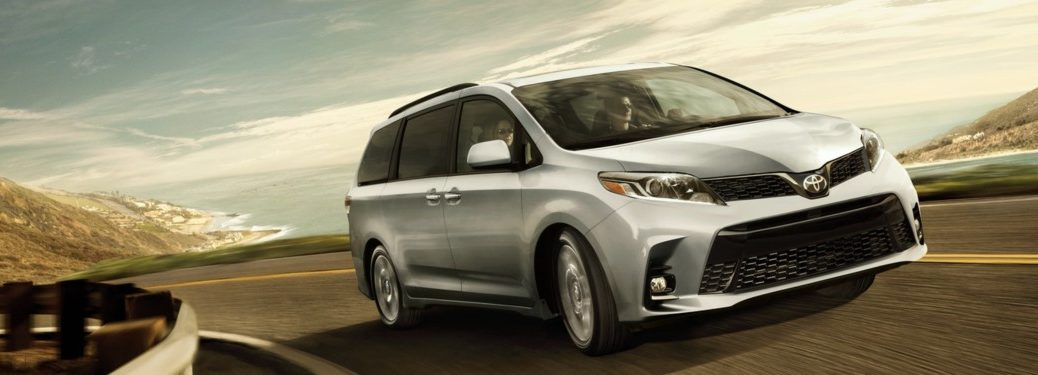 2019 Toyota Sienna driving down a highway road