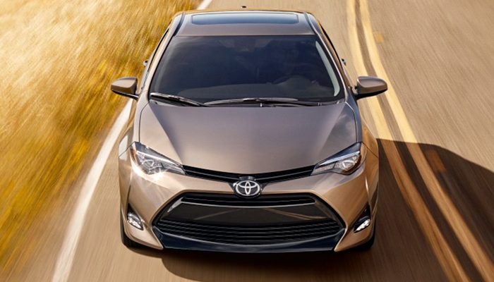 2019 Toyota Corolla driving down a rural road