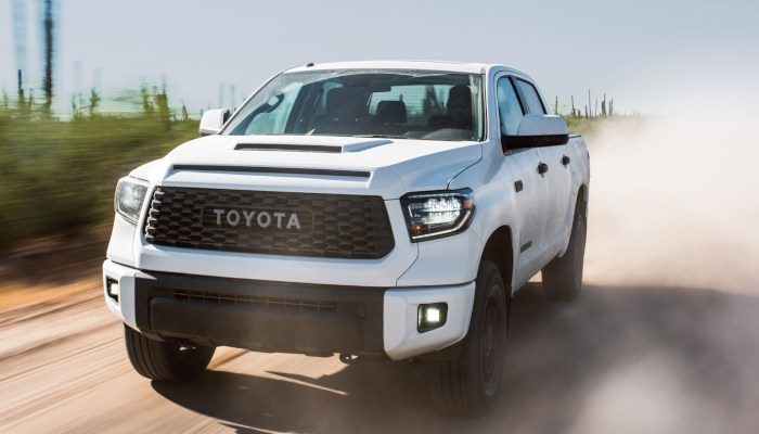2019 Toyota Tundra driving fast down a dirt road