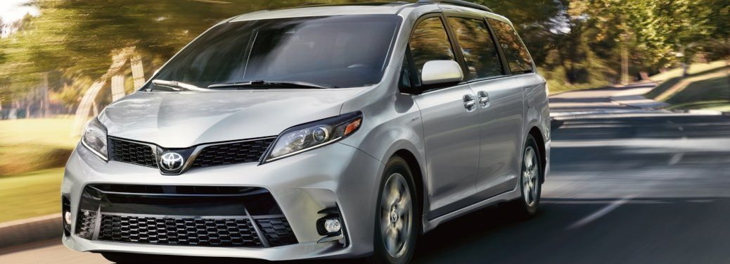 2019 Toyota Sienna driving down a park road