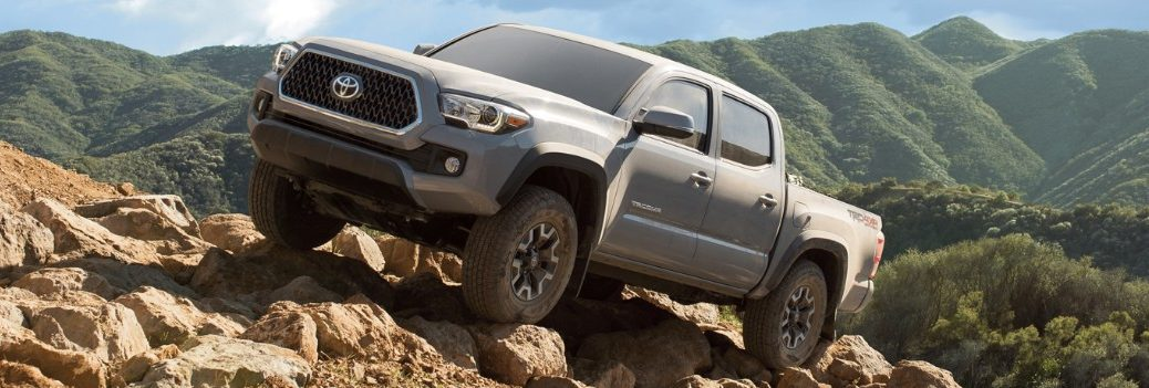 2019 toyota tacoma driving up a cliff