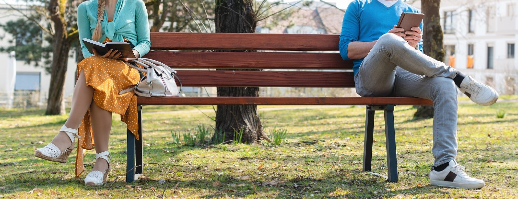 people social distancing on a bench
