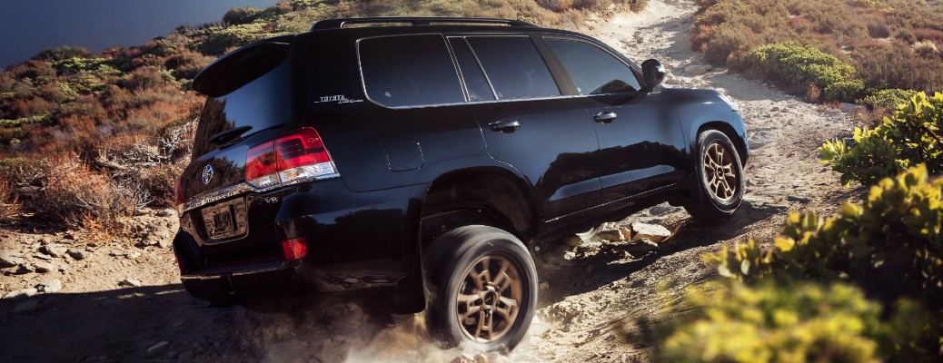 2021 Toyota Land Cruiser driving up dirt road